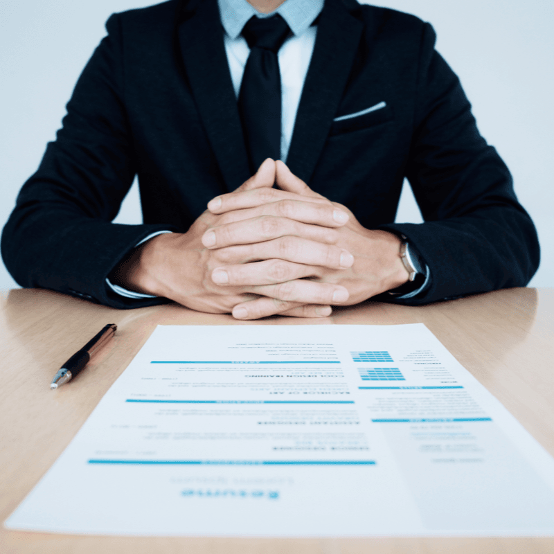 Photo of person sitting at desk with resume