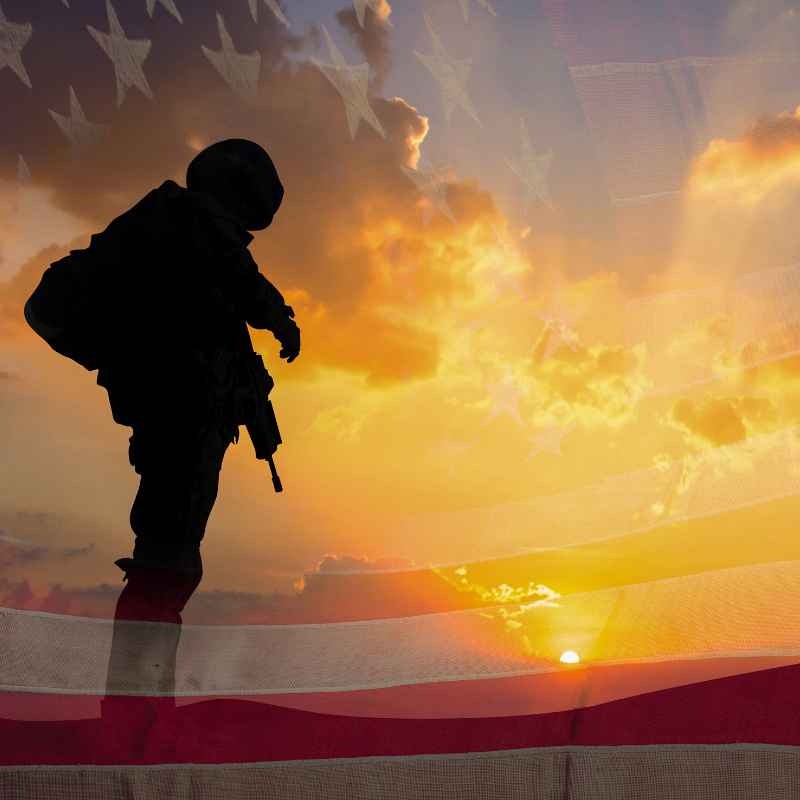 Photo of military person in sunset